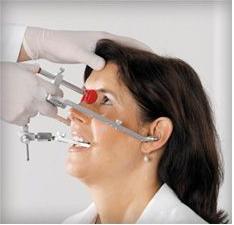 Rozwiązywanie problemów okluzyjnych za pomocą łuku twarzowego i artykulatora